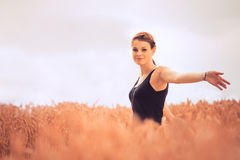 Beautiful young woman in nature feeling happy and free Royalty Free Stock Photography