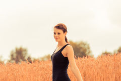Beautiful young woman in nature feeling happy and free Royalty Free Stock Images