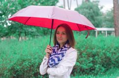 Beautiful young woman on nature park umbrella Royalty Free Stock Images
