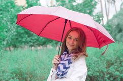 Beautiful young woman on nature park umbrella Stock Images