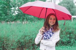 Beautiful young woman on nature park umbrella Stock Photography