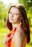 Beautiful young woman on nature in the park. Wind in the hair Stock Images