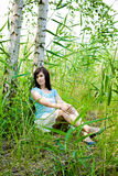 Beautiful young woman in nature Stock Photography