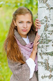 Beautiful young woman near birch Royalty Free Stock Image