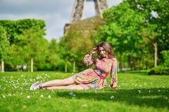 Beautiful young woman near the Eiffel tower Stock Images