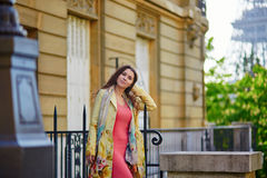 Beautiful young woman near the Eiffel tower in Paris Royalty Free Stock Photography