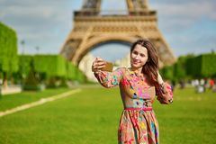 Beautiful young woman near the Eiffel tower Royalty Free Stock Photo