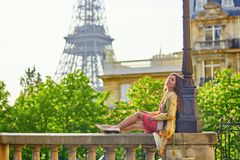 Beautiful young woman near the Eiffel tower Stock Photos