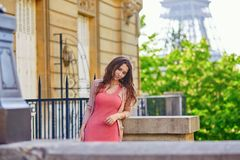 Beautiful young woman near the Eiffel tower Stock Photography