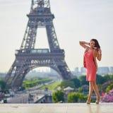 Beautiful young woman near the Eiffel tower Stock Photo