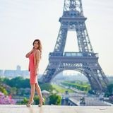 Beautiful young woman near the Eiffel tower Royalty Free Stock Photography