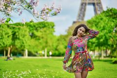 Beautiful young woman near the Eiffel tower Royalty Free Stock Image