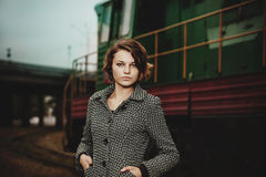 Beautiful young woman near old train Stock Images