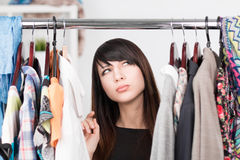 Beautiful young woman near rack with clothes Stock Photos