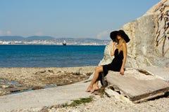 Beautiful young woman near the sea Stock Image
