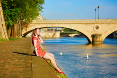 Beautiful young woman near the Seine in Paris Stock Photos