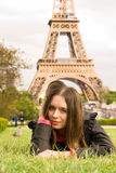 Beautiful young woman near to Eiffel Tower. Spring portrait of young woman in Paris Royalty Free Stock Image