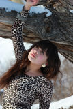Beautiful young woman near the winter oak. Beautiful young girl near the old oak tree Royalty Free Stock Photo