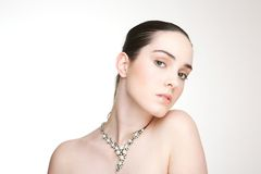 Beautiful young woman with necklace Stock Images