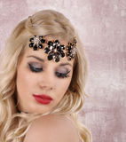 Beautiful young woman with a necklace on her head. Beautiful young woman with a  necklace on her head Royalty Free Stock Photos