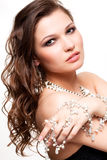 Beautiful young woman in necklace. Portrait of beautiful young brunette woman in and earrings on white background Stock Images