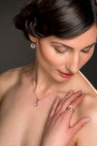 Beautiful young woman with necklace. And ring Royalty Free Stock Photos