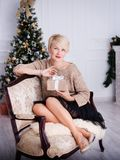 Beautiful young woman in the New Year decorations. New year concept Stock Image