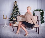Beautiful girl in the New Year decorations. Beautiful young woman in the New Year decorations New year concept Royalty Free Stock Photography