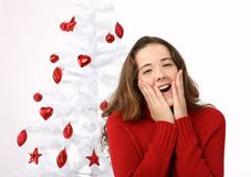Beautiful young woman next to christmas tree Stock Images