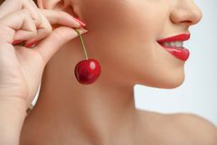 Beautiful young woman with nice red earring Royalty Free Stock Images