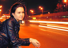 Beautiful young woman in night city Stock Images