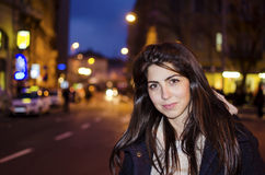 Beautiful young woman on the night street .street night lights Royalty Free Stock Photos