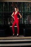 Beautiful young woman in nightclub Stock Image