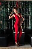 Beautiful young woman in nightclub Stock Photo
