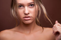 Beautiful young woman with no make up and perfect skin Royalty Free Stock Images