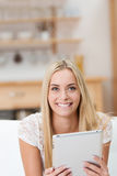 Beautiful young woman with a notepad Stock Photography