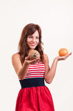 Beautiful young woman offers a coconut instead of grapefruit Stock Photography