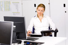 Beautiful young woman at the office stock photos