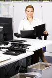 Beautiful young woman at the office Royalty Free Stock Image