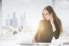 Beautiful young woman in office Stock Images