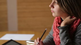 Beautiful young woman in the Office writes with pen stock video