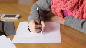 Beautiful young woman in the Office writes with pen stock video footage