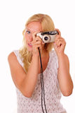 Beautiful young woman with an old camera Royalty Free Stock Photography