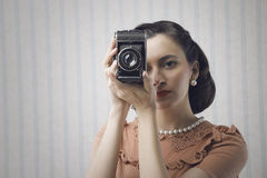 Woman with a old camera Royalty Free Stock Photos