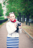 Beautiful young woman with old retro camera outdoor Stock Images