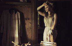 Beautiful young woman at an old rustic cottage Royalty Free Stock Image