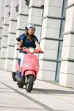Beautiful Young Woman On Scooter Stock Photo