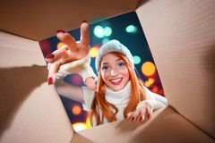 Christmas and New Year holidays. Happy woman open gift box. stock image