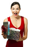 Beautiful young woman opening gift. Box looking very excited Royalty Free Stock Image