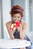 Beautiful young woman opening gift box Stock Image